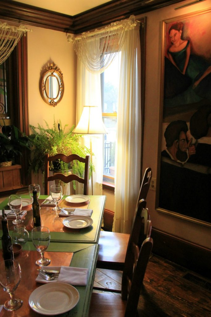 Mouzon House dining room with Copper tables and murals celebrating the homes Cherokee-Creole heritage